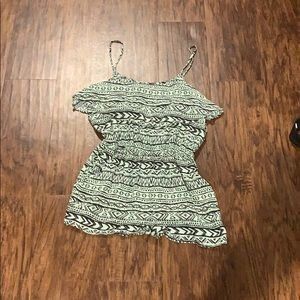Patterned teal romper with cut out on the back